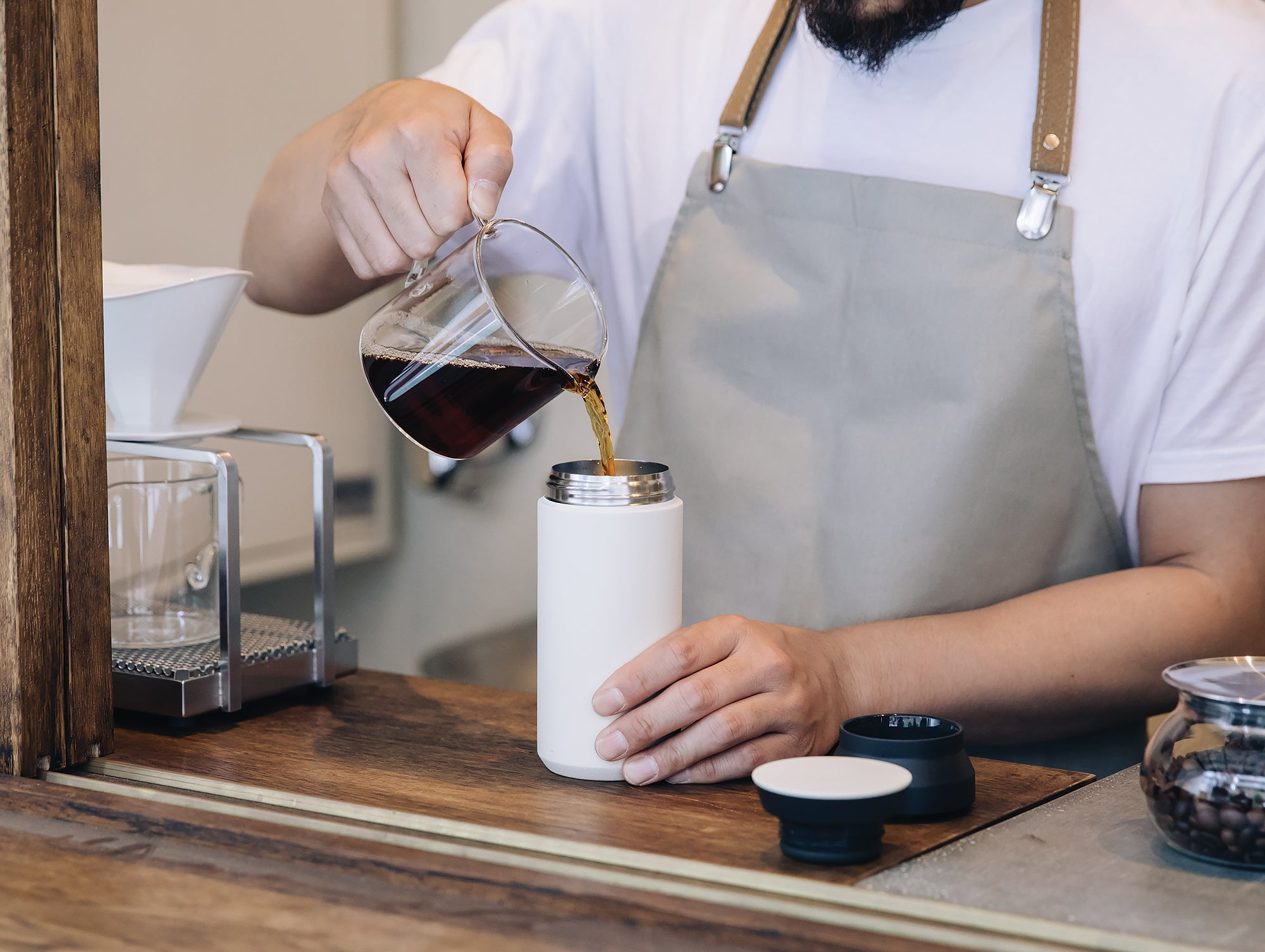 Filling up the Kinto Travel Tumbler with fresh coffee