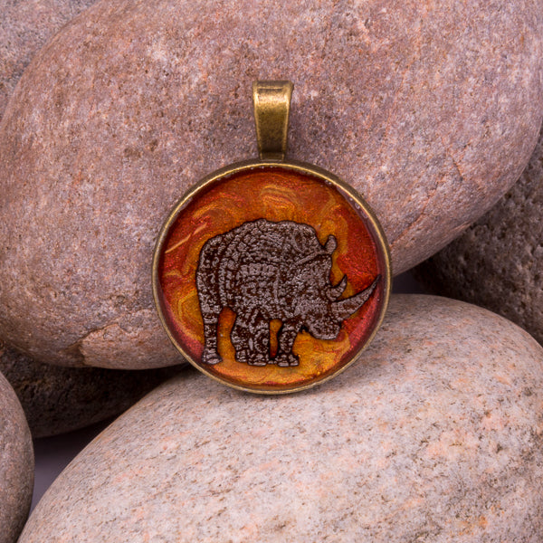 Handcrafted Bespoke Mighty Rhino Pendant; set in bronze effect metal bezel.| Jabbawocky Crafts (jabbawockycrafts.co.uk)