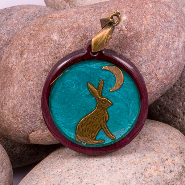Handcrafted Bespoke Moon Gazing Hare Pendant; set in contemporary purple heart wood.| Jabbawocky Crafts (jabbawockycrafts.co.uk)