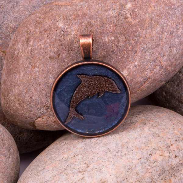 Handcrafted Bespoke Leaping Dolphin Pendant; set in copper effect metal bezel.| Jabbawocky Crafts (jabbawockycrafts.co.uk)