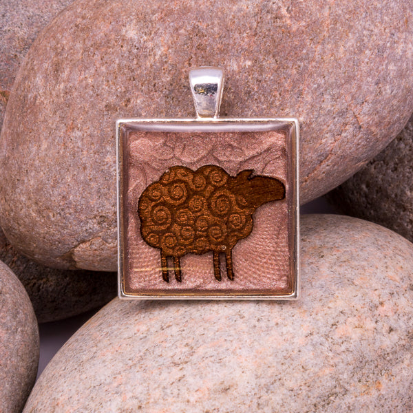 Handcrafted Bespoke Woolly Sheep Pendant; set in silver effect metal bezel.| Jabbawocky Crafts (jabbawockycrafts.co.uk)
