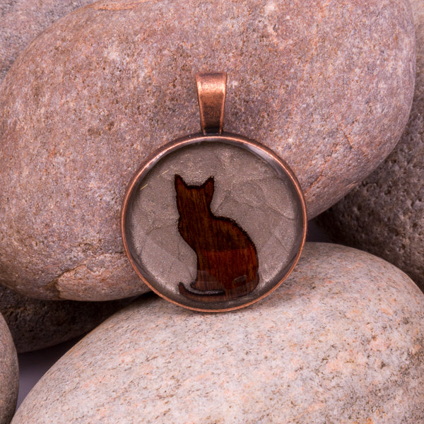 Handcrafted Bespoke Curious Cat Pendant; set in copper effect metal bezel.| Jabbawocky Crafts (jabbawockycrafts.co.uk)