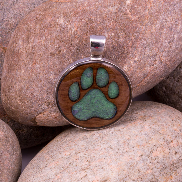 Handcrafted Bespoke Dog Paw Print Pendant; set in A Dog Pawprint (made from gilted walnut)| Jabbawocky Crafts (jabbawockycrafts.co.uk)