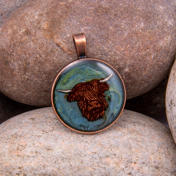 Handcrafted Bespoke Highland Cow Pendant; set in Copper Effect metal bezel.| Jabbawocky Crafts (jabbawockycrafts.co.uk)