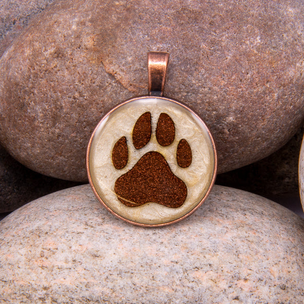 Handcrafted Bespoke Dog Paw Print Pendant; set in Copper Effect metal bezel.| Jabbawocky Crafts (jabbawockycrafts.co.uk)