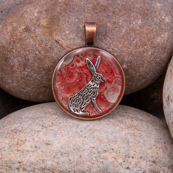 Handcrafted Bespoke Moon Gazing Hare Pendant; set in Copper Effect metal bezel.| Jabbawocky Crafts (jabbawockycrafts.co.uk)