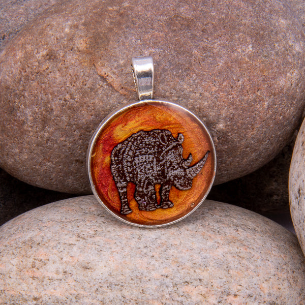 Handcrafted Bespoke Mighty Rhino Pendant; set in Silver Effect metal bezel.| Jabbawocky Crafts (jabbawockycrafts.co.uk)