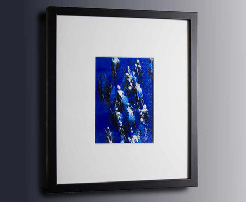 Racing - a small original painting framed in a black frame with white mount by Neil McBride