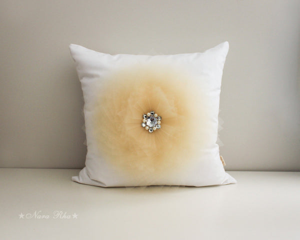 beige flower pillow