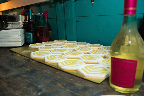 Sparkling wine and logo cookies ready to go.