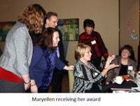 Maryellen receiving award