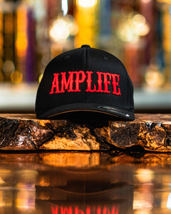 "AMPLIFE Black with Red 3D Puff Embroidery.   Flex Fit, Curve Bill  Represent THE AMP LIFE proudly with our Flex Fit Hats.   S/M (6 3/4"" - 7 1/4"") L/XL (7 1/8"" - 7 5/8"")"