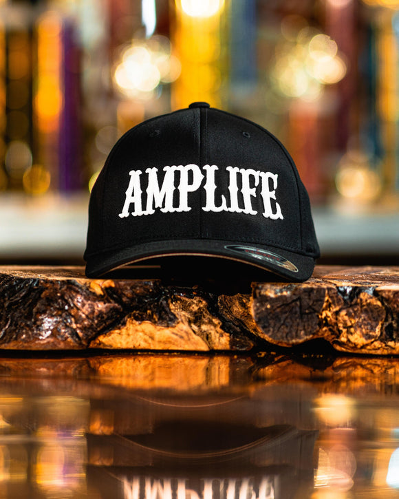 "AMPLIFE Black with White 3D Puff Embroidery.   Flex Fit, Curve Bill  Represent THE AMPLIFE proudly with our Flex Fit Hats.  S/M (6 3/4"" - 7 1/4"") L/XL (7 1/8"" - 7 5/8"")"
