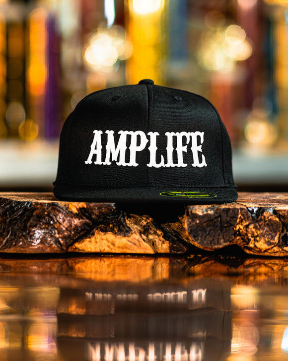 "AMPLIFE Black with White 3D Puff Embroidery. Flex Fit, Flat Bill  Represent THE AMP LIFE proudly with our Flex Fit Hats.  S/M (6 7/8"" - 7 1/4"") L/XL (7 1/4"" - 7 5/8"")"