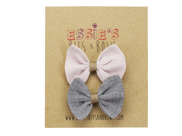 Blush pink and grey linen baby bows on a display card