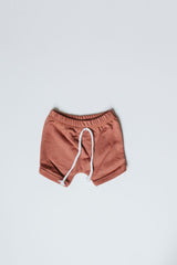 terra-cotta curved hem harem shorts