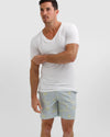 Model%20wears%20mosmann%20board%20shorts%20and%20white%20tee.jpg