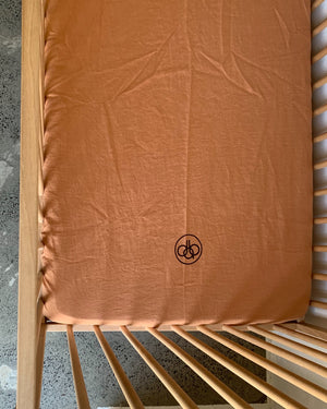 fitted cot . caramel. dba ready dyed linen
