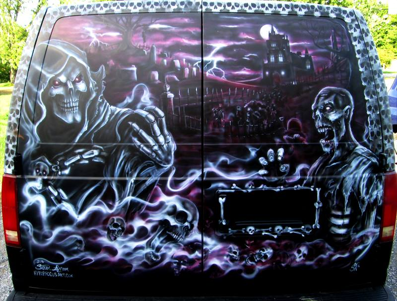 Custom airbrushed grim reaper, zombie, black white & red graveyard on the back of the Halford Motors van.
