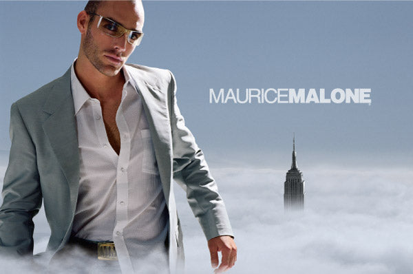 2004 Maurice Malone men's fashion advertisement of a giant man in tailored suit walking through clouds in New York City