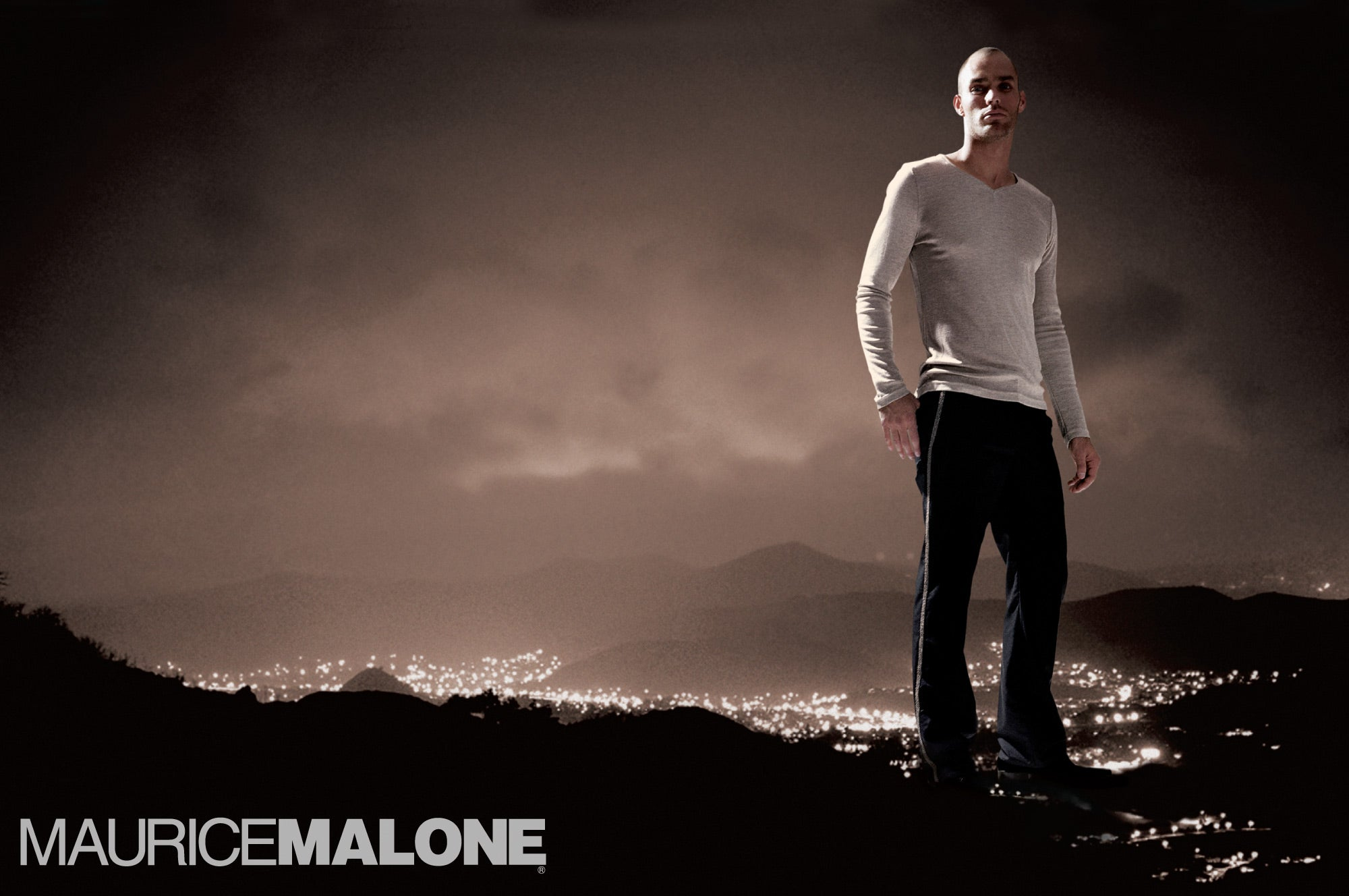 2004 Maurice Malone fashion advertisement shows a giant man standing over the hills in Los Angeles