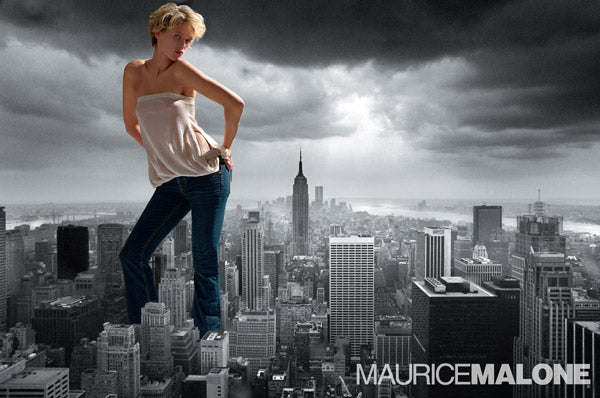 2004 women's denim advertisement shows a giant lady wearing Maurice Malone jeans over New York City