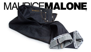 Denim designer Maurice Malone's streetwear brand home features iconic logo cuff jeans