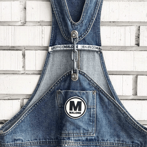 @eat_gifu close-up of vintage chain-link denim overalls by Maurice Malone with circle logo