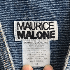 Label of vintage Maurice Malone denim overalls made in the USA
