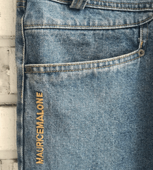 Maurice Malone branding at the hip of jeans were a brand trademark in the early 90's