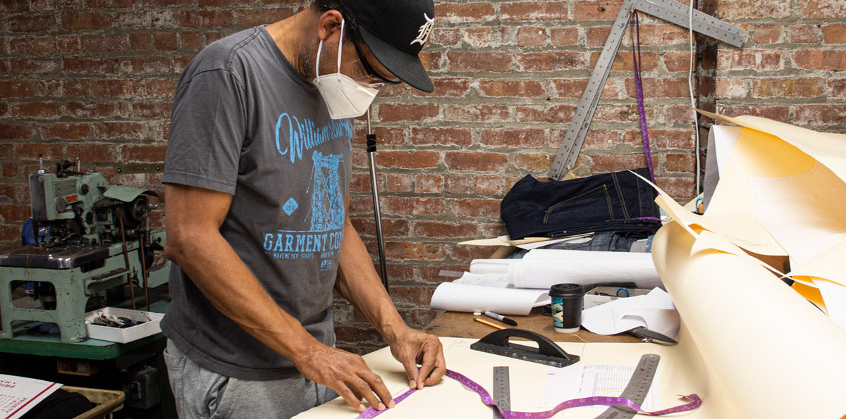 Denim designer Maurice Malone working on jean patterns inside his Brooklyn NY workshop.