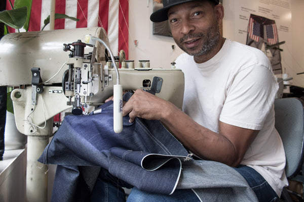 Maurice Malone sewing denim jeans in his Williamsburg Garment Company store