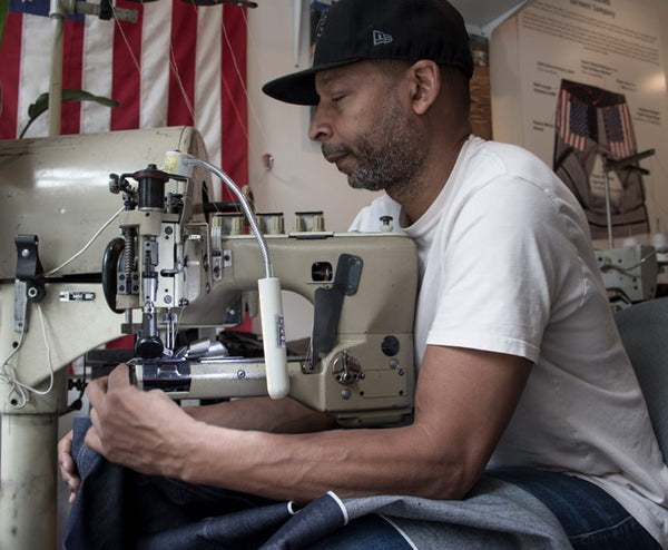 Denim designer Maurice Malone sewing handmade jeans at Williamsbug Garment Company
