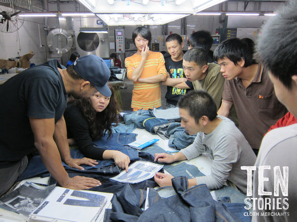 Denim Designer Maurice Malone works with technical and wash staff in Chinese washing factory.