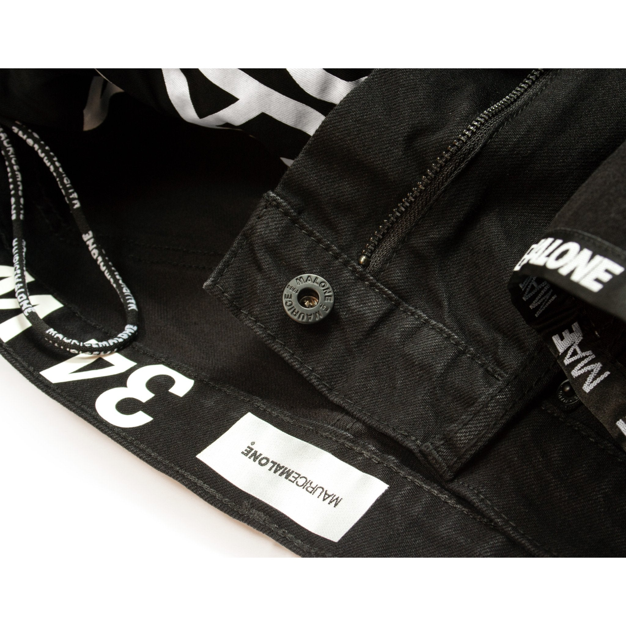 Inside jean details feature branded hanger loops, pocket bags and soft heat applied satin waistband label.