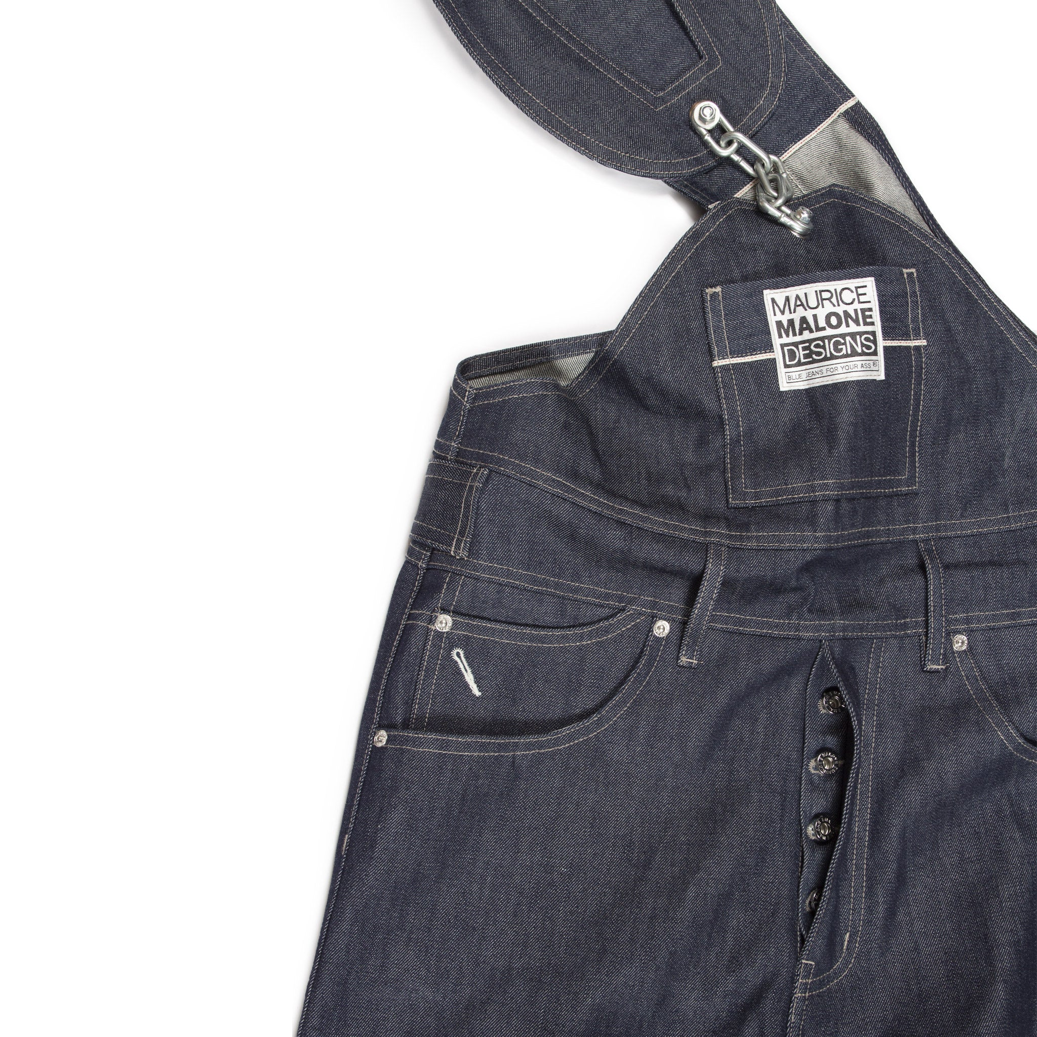 Close-up of chain-link selvedge raw denim overalls by Maurice Malone