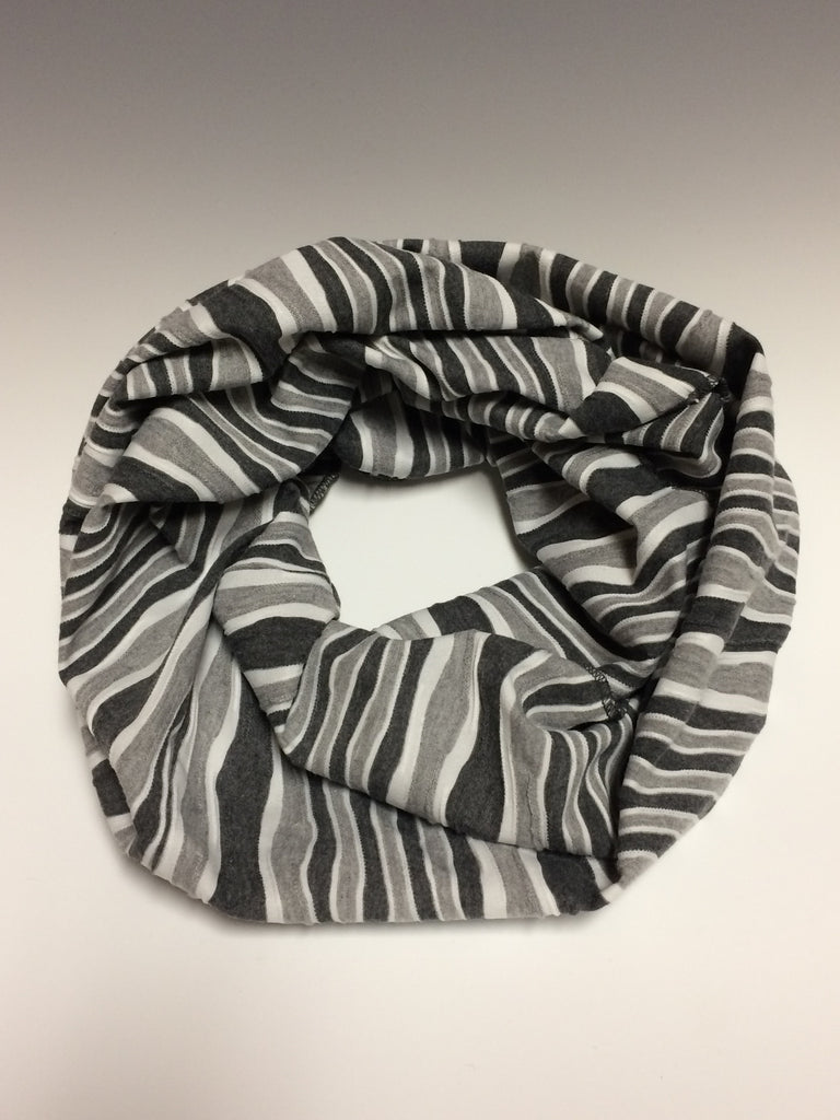 "Need a scarf for many occasions? This is it! The neutral wavy gray and white  tones  make for a great accent to most any outfit. The scarf measures an 18"" by 60"" infinity loop and is made of a comfortable poly/rayon blend. Hand made in America."
