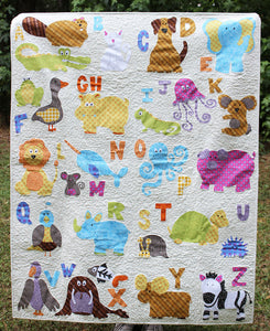 Photo of a finished quilt made from the ABC Animals Applique Quilt Paper Sewing Pattern by Jennifer Jangles