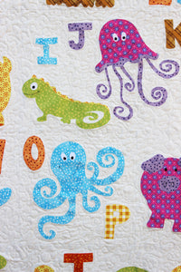 Close up of the appliquéd jellyfish, iguana, and octopus featured on the ABC Animals Applique Quilt Paper Sewing Pattern by Jennifer Jangles