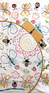 Embroidery Pattern - Flowers and Insects by Jennifer Jangles, displayed in an embroidery