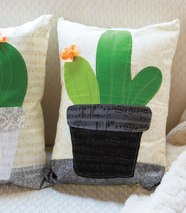Close up of finished cactus accent pillow made from the Cactus Applique Pillows Sewing Pattern by Jennifer Jangles