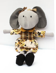 Girl Elephant Doll featured in the Make A Friend - Elena Elephant Sewing Pattern by Jennifer Jangles