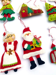 Mrs. Claus and Santa felt ornament included in the 12 Felt Holiday Ornaments Sewing Pattern Kit by Jennifer Jangles