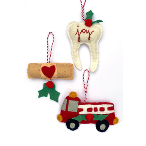 Tooth, bandaid, & firetruck ornaments included in the Fireman, Nurse, and Dentist Felt Holiday Ornaments Sewing Pattern by Jennifer Jangles