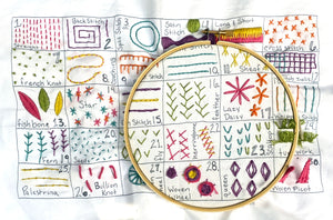 30 Day Embroidery Sampler on an embroidery hoop - Embroidery Pattern by Jennifer Jangles