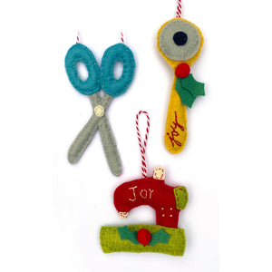 Scissors, rotary cutter & sewing machine ornaments included in the Sewing and Quilting Felt Holiday Ornaments Sewing Pattern by Jennifer Jangles