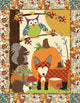 A Walk in the Woods Quilt Sewing Pattern by Jennifer Jangles featuring an appliquéd owl, squirrel, fox, pumpkin, hedgehog, and mushrooms.