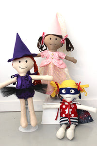 Dolls wearing Witch, Princess, Superhero outfits featured in the  Make a Friend Dress Up Clothes Sewing Pattern by Jennifer Jangles