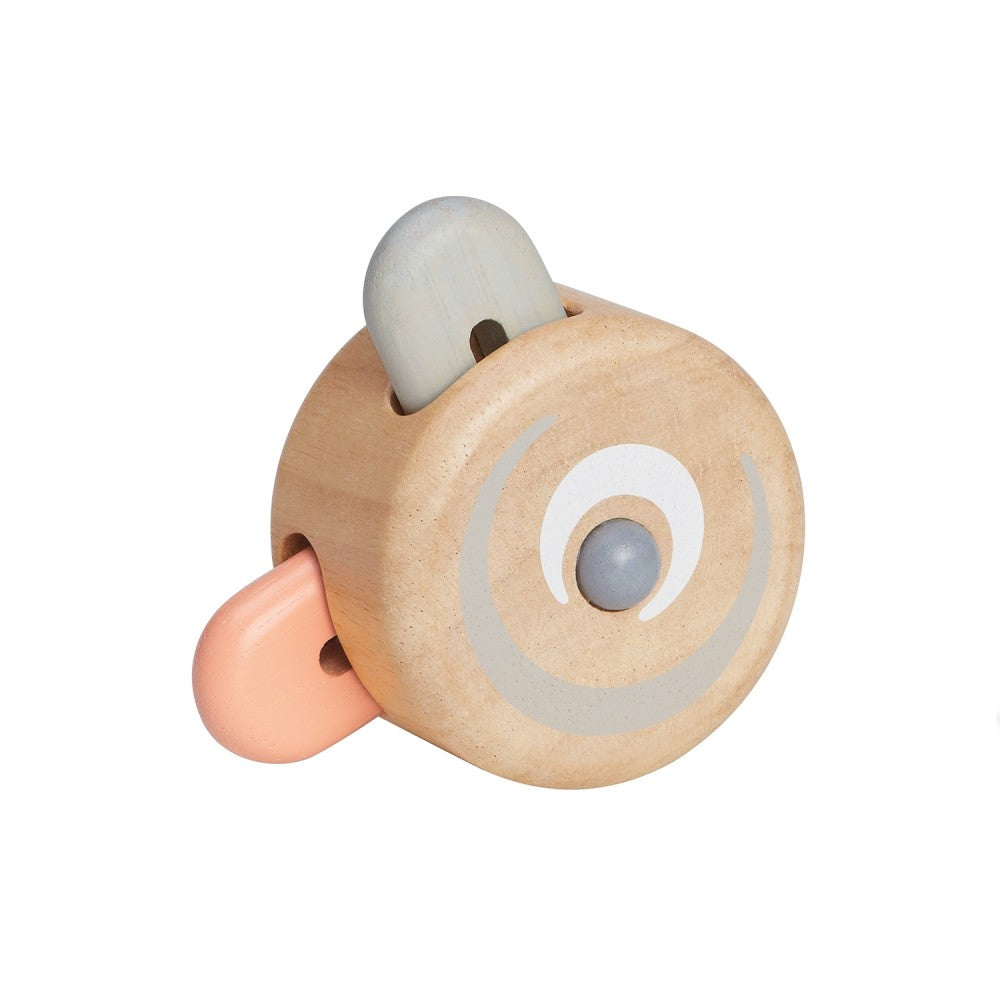 plan peek-a-boo roller toy has colored pieces that pop in and out as the toy rolls