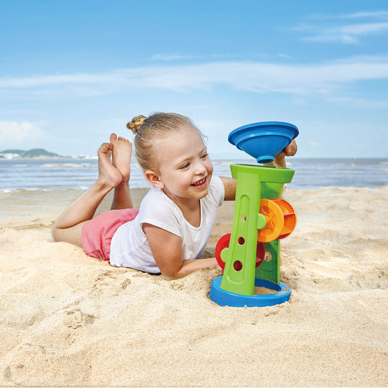 Hape Double Sand and Water Wheel is red, green, yellow, and blue and two pieces.